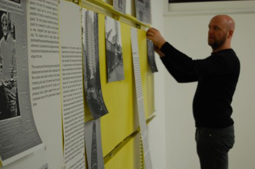 installing archive materials for Iniva's Social Fabric exhibition